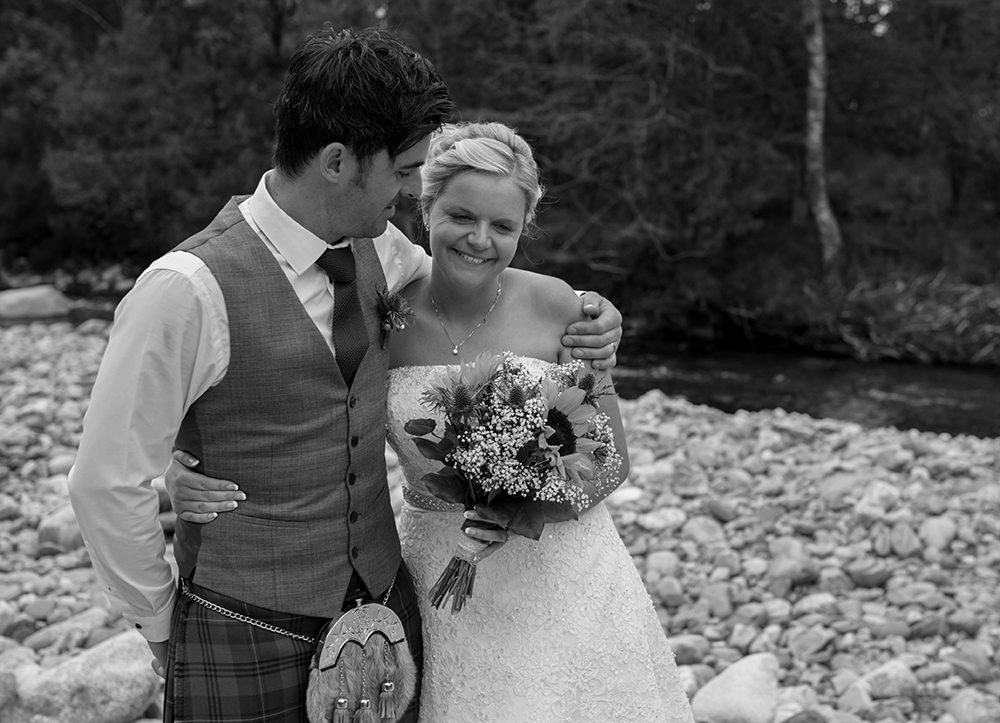 couple shoot by river Inverness wedding