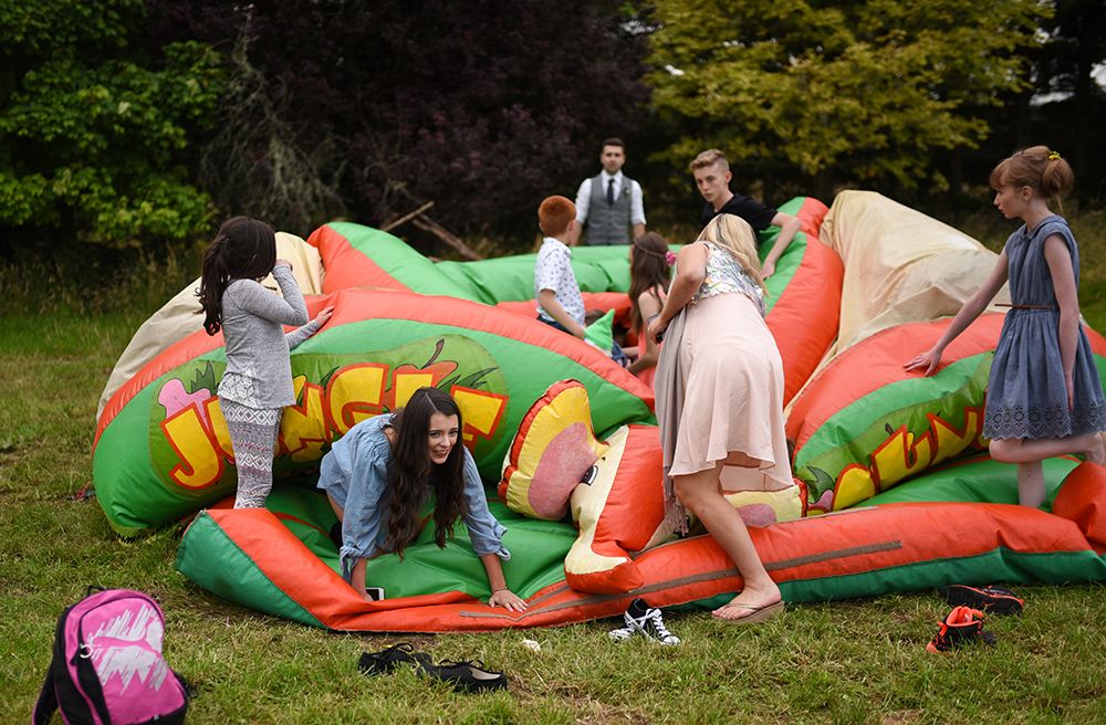 bouncy castle at festival wedding