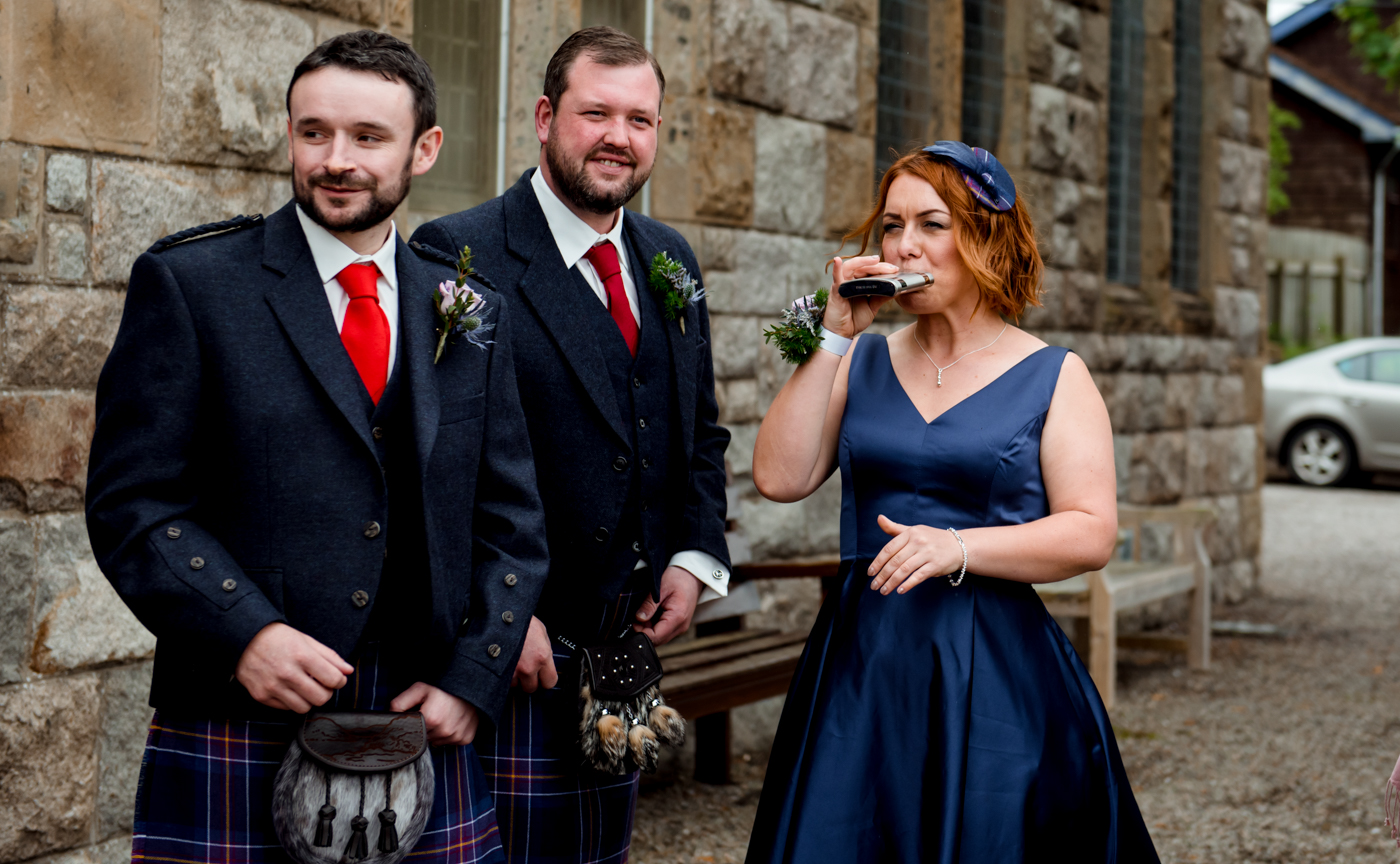 groomsman with hip flask